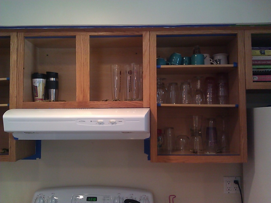 sand or de-gloss the cabinets